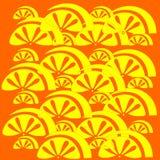 Yellow fruit pattern on an orange background. Stock Photo