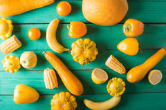 Yellow fruits and vegetables on a turquoise wooden background Stock Photography