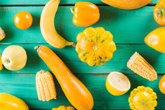 Yellow fruits and vegetables on a turquoise wooden background. Colorful festive still life. Copyspace. Yellow squash, melon, lemon Stock Image