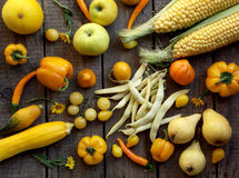 Yellow fruits and vegetables. On a wooden background stock image