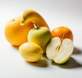 Yellow fruits on white background Stock Image