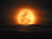 The yellow full moon and cloud on night sky. Background for your night or dark concept design. High Quality of full moon photo Royalty Free Stock Photos