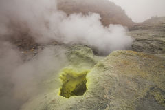 Yellow fumaroles and volcanic rocks. Stock Photography