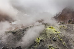 Yellow fumaroles and volcanic rocks. Royalty Free Stock Photography