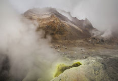 Yellow fumaroles and volcanic rocks. Royalty Free Stock Image