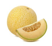 Yellow galia melon piece isolated on white background royalty free stock photography