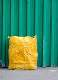 Yellow garbage bag Royalty Free Stock Images