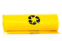 Yellow garbage bio bags. In a roll on white background Royalty Free Stock Photography
