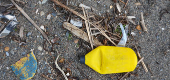 Yellow garbage bottle Royalty Free Stock Photography
