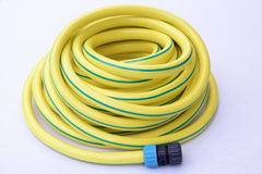 Yellow garden  hose-pipe Royalty Free Stock Photography