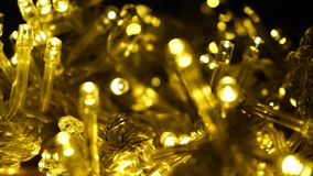 Yellow garlands for fall decor. Garlands in yellow for warm autumn ambience. Twinkling lights perfect for  indoor ornament. Concept of  cute embellishment for stock footage