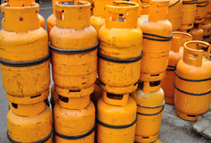 Yellow gas cylinder Stock Photo