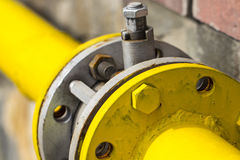 Yellow gas pipe with a crane and gear Royalty Free Stock Photo