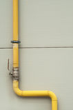 Yellow gas pipe with a crane and valve Stock Photography