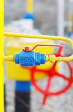 Yellow gas pipe with a crane Stock Image