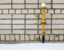 Yellow gas pipe. In front of residential building wall royalty free stock images