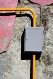 Yellow gas pipe gauge box close-up foto. Yellow gas pipe grey gauge box close-up foto stock photography