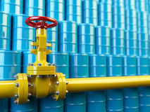 Yellow gas pipe line valves and blue oil barrels. Fuel and energ Stock Images