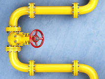 Yellow gas pipeline valve on a blue wall. Space for text. Royalty Free Stock Photos