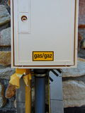 Yellow gas sign on white box. Yellow gas sign in the center of white box royalty free stock image