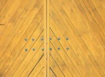 Yellow gate closeup with diagonal wooden strips Stock Photo