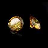 Yellow gems on a black background Stock Images