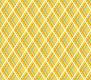 Yellow geometric background, seamless, fine lines, diamonds, vector. Thin orange and blue lines cross on a yellow field. Vector decor Royalty Free Stock Photo