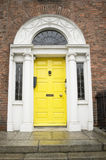 Yellow georgian door Royalty Free Stock Images