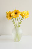 Yellow gerberas in glass vase Royalty Free Stock Images