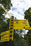 Yellow German finger post sign. Attractions at Neuschwanstein. B Stock Photo