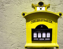 Yellow German mail box Royalty Free Stock Photography