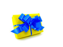 Yellow gift box. With blue robbon isolated on white royalty free stock image