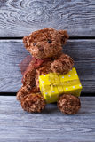 Yellow gift box from bear. Stock Images