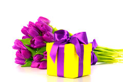 Yellow gift box with bouquet of purple tulips Royalty Free Stock Photos