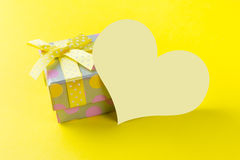 Yellow gift box with plain card Stock Images