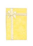 Yellow gift box with ribbon and bow isolated on white Stock Photo