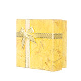 Yellow gift box with ribbon and bow isolated on white Royalty Free Stock Photos