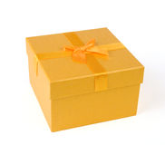 Yellow gift box Stock Images