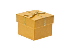 Yellow gift box with ribbon on a white background Royalty Free Stock Photo
