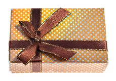 Yellow gift box tied by brown ribbon stock photo
