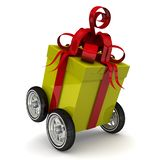 Yellow gift box on wheels. Yellow gift box with red tapes and a bow on four wheels. Isolated on white background. 3D Illustration royalty free illustration