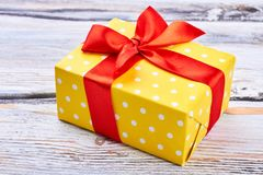 Free Yellow Gift Box With Red Ribbon. Royalty Free Stock Image - 104877416