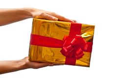 Yellow gift box in woman's hand Royalty Free Stock Image