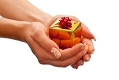 Yellow gift box in woman's hand Royalty Free Stock Images