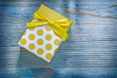 Yellow gift box on wooden board holidays concept Royalty Free Stock Photos