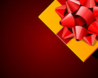 Yellow gift with red bow top view Royalty Free Stock Photos