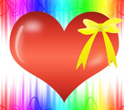 Yellow gift ribbon bow on red heart Royalty Free Stock Image