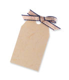 Yellow gift tag tied with ribbon (including clipping path) Royalty Free Stock Photos