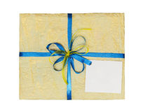 The yellow gift which is elegantly packed into crumpled paper Royalty Free Stock Photography