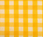 Yellow Gingham Background. Yellow Gingham or checked tablecloth background Royalty Free Stock Photography